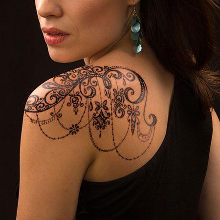 Ornamental lace tattoo on shoulder