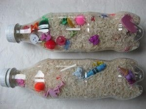 """I Spy Bottles:  Love this!  Use an empty plastic bottle, fill with rice and small objects to make your very own """"I Spy"""" bottle."""