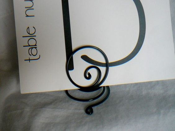 I like this stand idea for the table numbers too