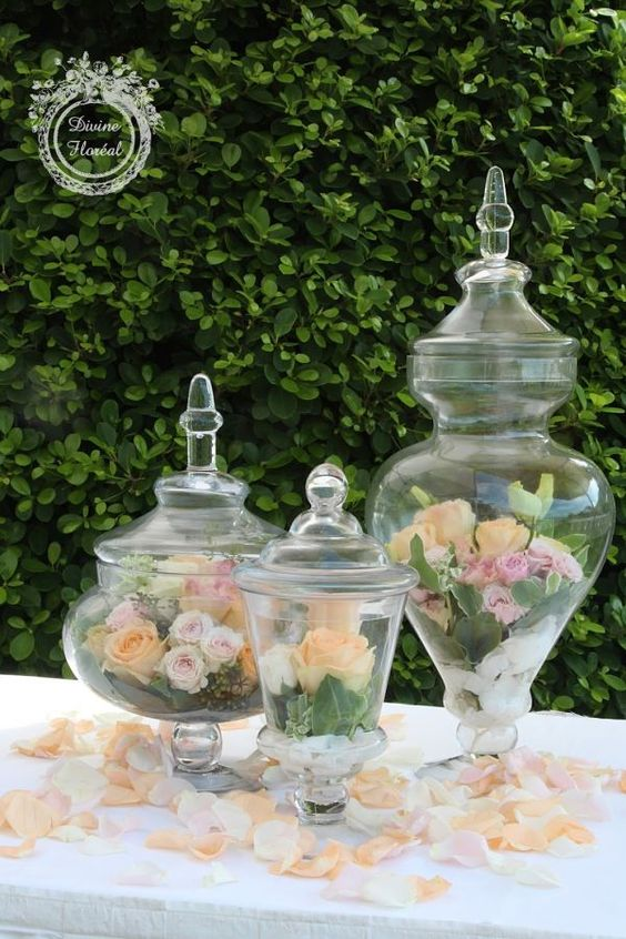 Fill wide mouth jar with white rocks and greens add bright silk florals of peach pinks tangerine hot pinks
