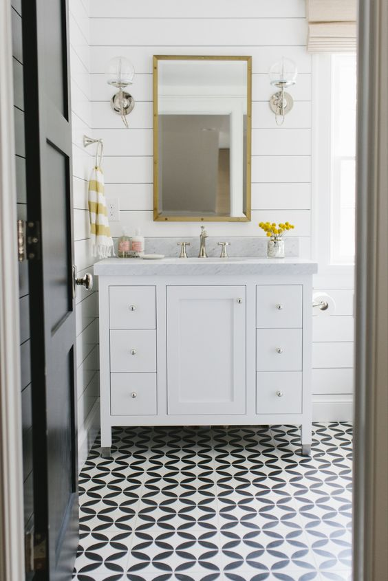 Out with the 1950s pink fixtures and in with cement tile and shiplap walls for one very happy guest bathroom. By Studio McGee: