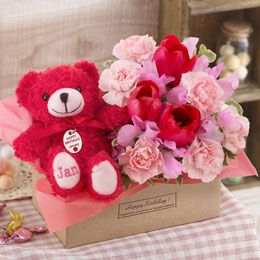 "Set of arrangements and ""Birthday Bear"" January"