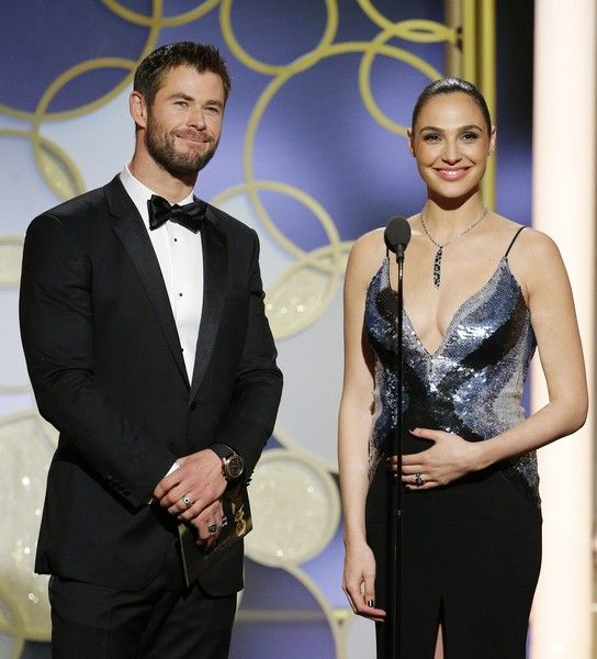 Presenters Chris Hemsworth and Gal Gadot are seen onstage during the 74th Annual Golden Globe Awards.