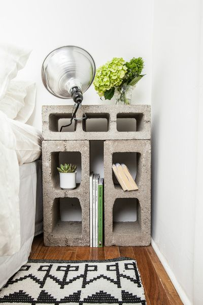 Nightstands fashioned from concrete blocks that were rescued from the street outside the building. Photo by Alan Gastelum.