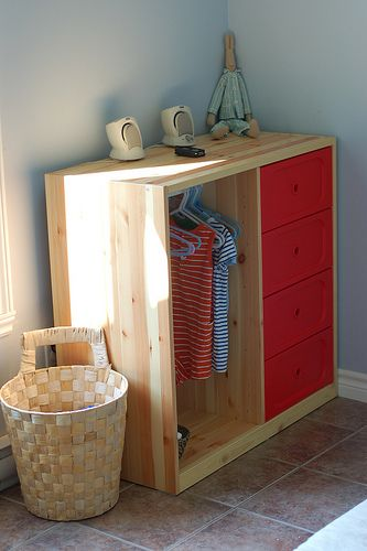 Dressing station for children. Reachable clothing, laundry basket, place to sit.:
