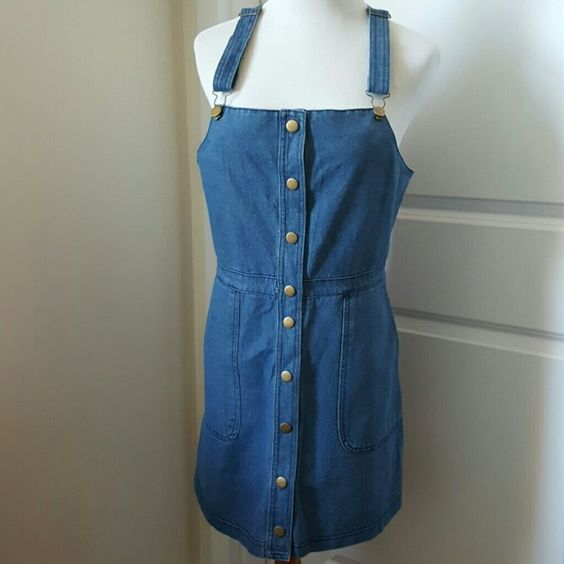 "Adorable denim jumper Super cute and on trend denim overall jumper with adjustable straps, pockets, and brass button closure down the front - can be worn SO many ways.  Measurements: bust 37"" waist 33"" length 34"" Dresses Mini"