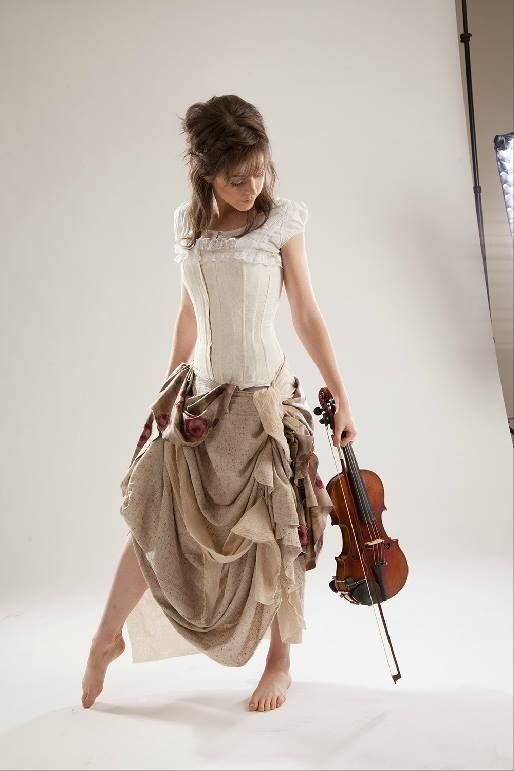 Lindsey Stirling (63) -- why do I find it impossible to stop pinning pix of her? Nice pose here, like a moment of reflection.