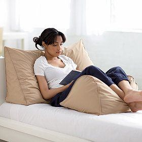 Firm, 95% Feather/5% Down Reading Wedge Pillow | The Company Store   --   Book lovers, rejoice! Reading in bed just got even cozier, thanks to our specially designed Reading Wedge Pillow. With a tall back and sloped front, this unique reading pillow provides extra support and cushioning for your back, so you can sit comfortably in bed (or in other places throughout your home) while holding your favorite books, magazines, e-readers and tablets.