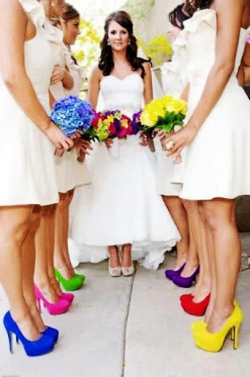"""""""White dresses, colored shoes, and matching flowers.  Groomsmen all white with colored tie matching the girls."""" Cute idea!"""