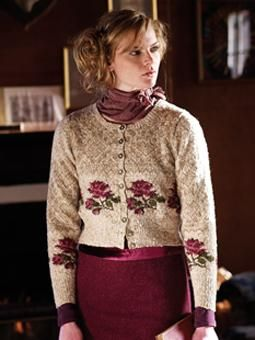 This elegant cardigan sweater has a rose motif and has been designed by Martin storey using Rowan Fine Tweed.