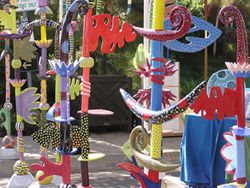 """Artist Leslie Codina makes """"sophisticated whimsy"""" totem sculptures.  Saw her at the Sunset Celebration Weekend.  Love the shapes and colors.  Gotta have one some day!"""