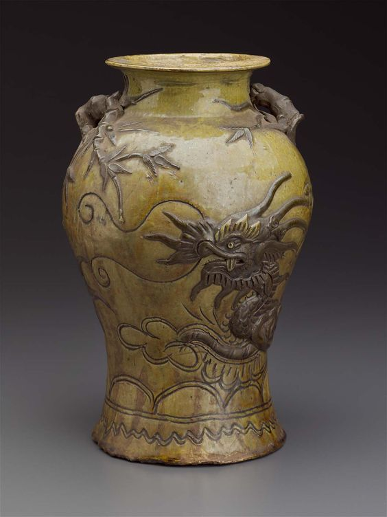 Vase.Vietnamese.18th century.  Stoneware with yellow-green and brown glaze, molded, incised, and applied decoration, molded and applied handles, Binh Duong kilns.  9 5/8 x 5 7/8 in.   MFA accession no 2007.392
