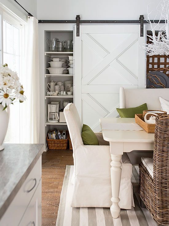 Beautiful sliding barn door covering kitchen storage area::