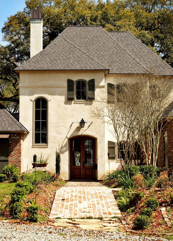 Yes creamy stucco color reddish brown brick and door for Country shutters exterior