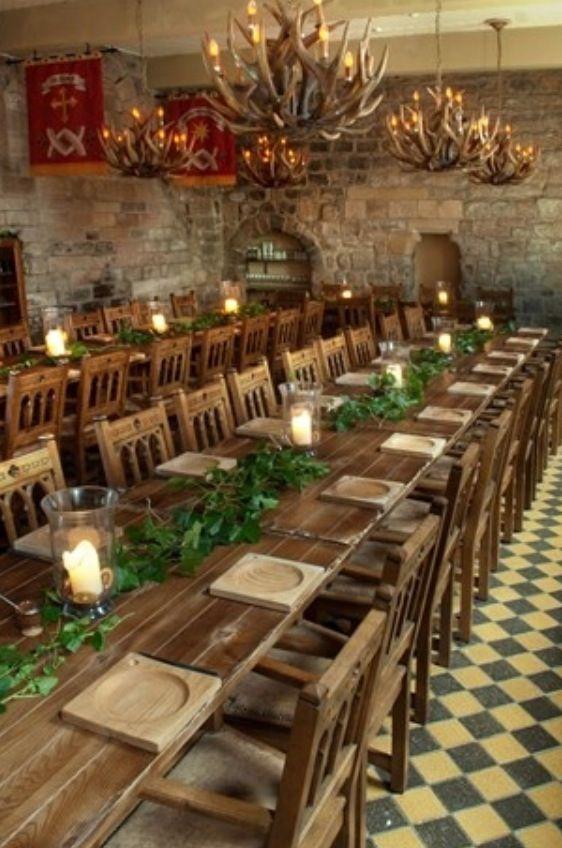 Long dinner tables plus rustic centre piece dinnerwear