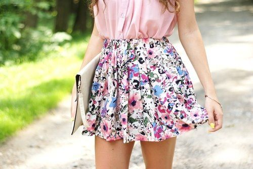 Pastel Pink Blouse Tucked Into A Floral Skirt Matched With A Pale Cream Clutch <3