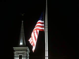 american flag at half mast rules