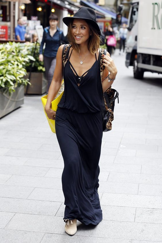 Pin for Later: Myleene Klass Isn't Letting the Colder Weather Affect Her Street Style  Myleene took her black beach dress (£29) to work by layering it over a bra with strapping detail and adding an animal-print bag and a black hat.