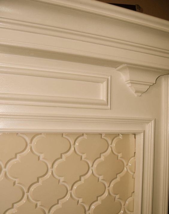 beveled arabesque tile on a fireplace for the home