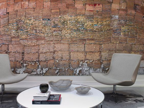 """Rottet built in a """"flaky oak"""" wall, its rough-hewn textures providing a striking counterpoint to the cool corporate space."""