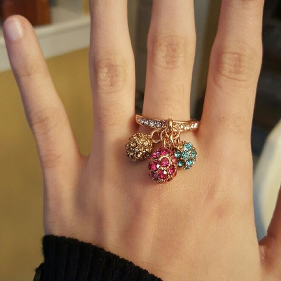 Size 7 roxi rose gold ring New never worn Roxi brand Rose.gold color with dangles Jewelry Rings