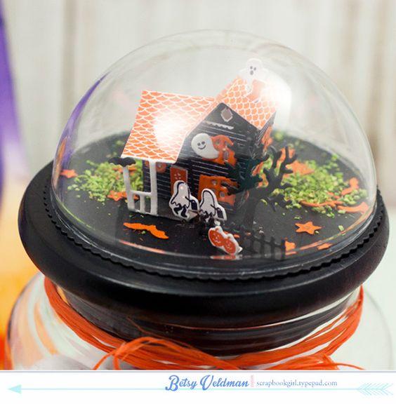 Mise en scène d'Halloween en 3D sous un dôme transparent.