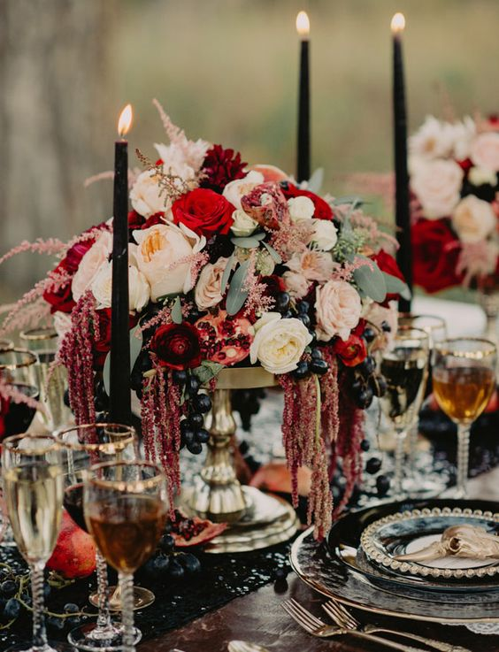 Burgundy centerpiece with pomegranates and dripping amaranthus