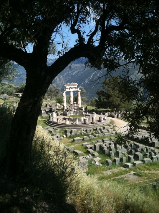 """Delphi - the center of the Earth - and home to the famous oracle. The place where Zeus set the stone called """"Omphalos,"""" which was guarded by the serpent Pythos. Pythos was slain by Apollo, the brilliant god of sun, music, medicine, and other such things."""