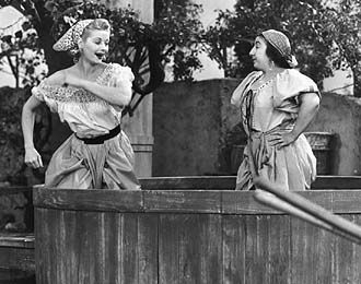 While the gang is in Europe, Lucy really wants to go to this famous orchard. Well she gets roped into working by smashing grapes. When she tries to leave the other lady in this picture tries to make her stay. Well Lucy does not speak italian and the lady does not speak english so they end up wresting eachother in a giant pool of grapes.