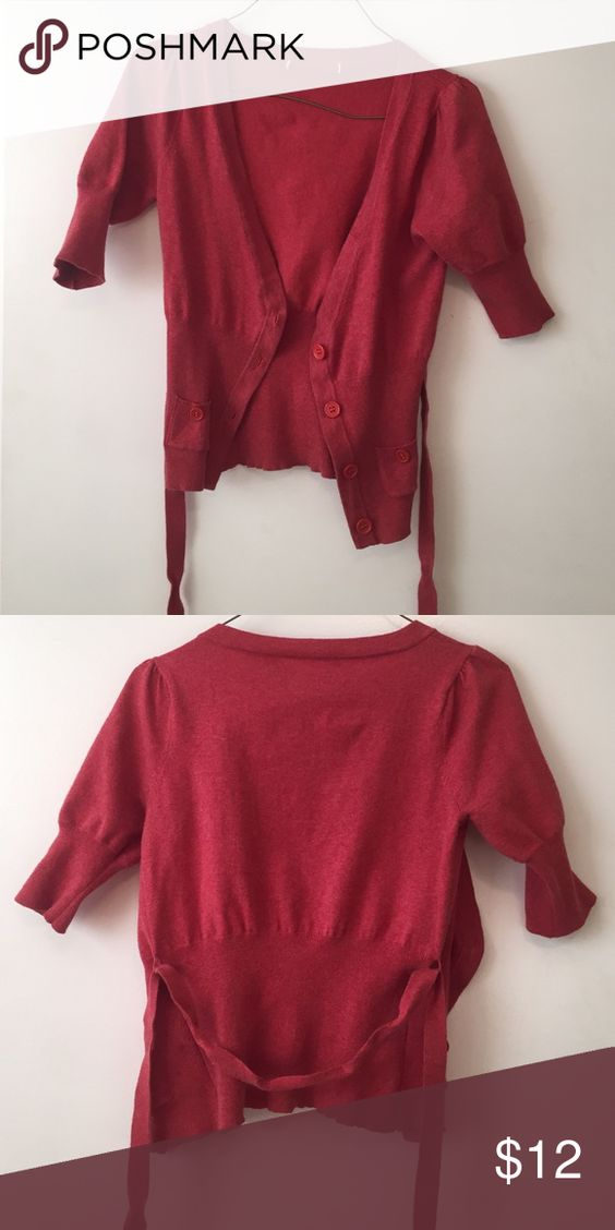 Super cute peachy pink sweater. Perfect condition. Darker peach color. Looks adorable on but I never wear it. Feel free to make me an offer! Anthropologie Sweaters Cardigans