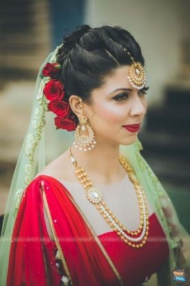 Bride Portrait Red Tube With Cape Blouse And Mint Green Dupatta Twisted Bridal Hair Bun And R Bridal Hair Buns Indian Bridal Hairstyles Indian Bride Makeup