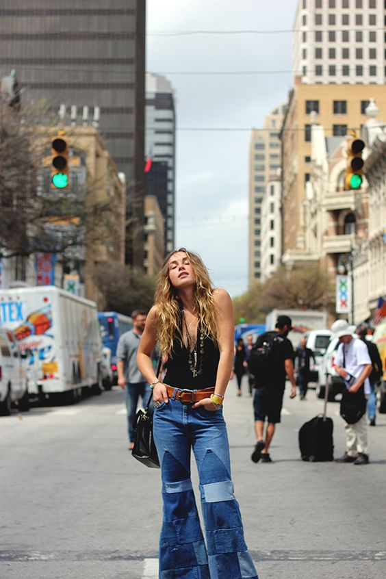 This young girl of today's 21st century time highly represents the styles worn in the 1970s. This young lady from Free People is wearing denim jeans, wide leg and a very wide belt. She also has her hair down and has a look of freedom and comfort. 3/26/2015