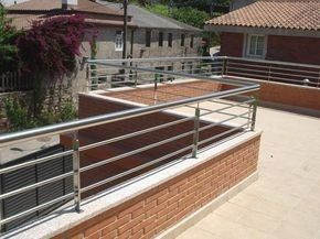A 2nd Tale Deck With Numerous Degrees Was Designed With Low Maintenance Products For The Floor Balcony Grill Design Balcony Railing Design Steel Railing Design