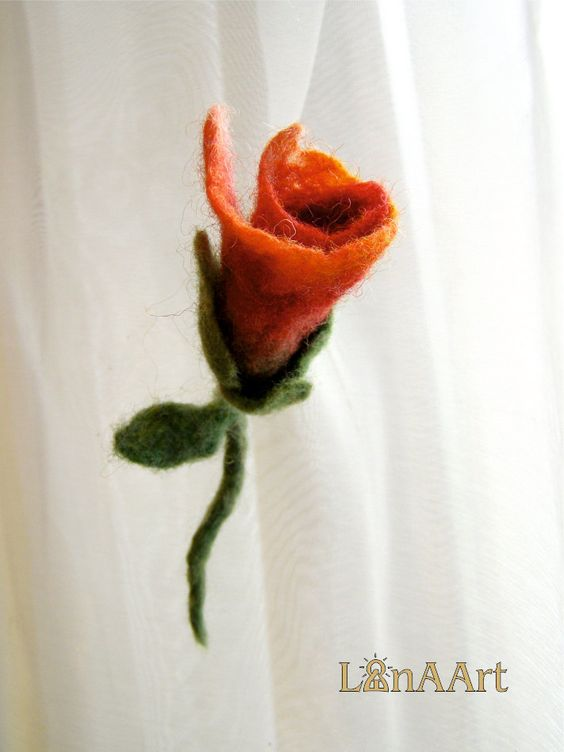 Small charming rosebud flower brooch pin in red, orange and green felted wool.