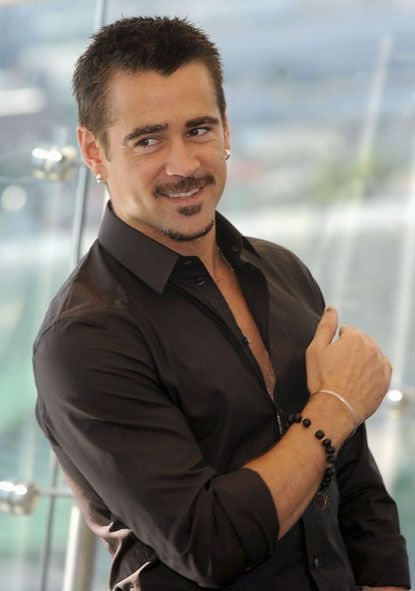 Colin Farrell poses during a photo shoot on the roof of the Ritz-Carlton Hotel to promote Len Wiseman's Total Recall remake prior to its Moscow premiere on August 8, 2012.
