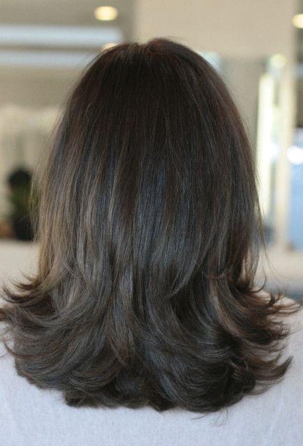 natural brunette hair color. I like how the hair falls on her shoulders.