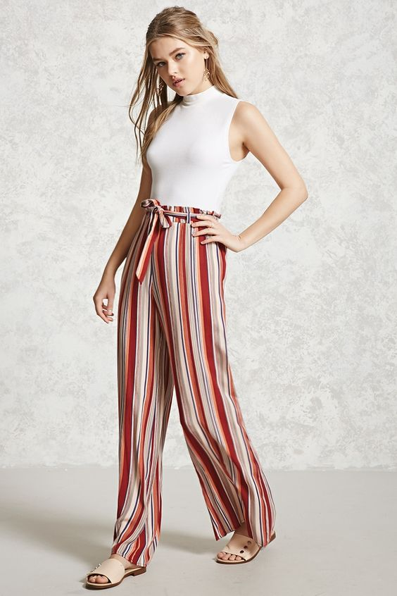A pair of woven palazzo pants featuring allover stripes, a wide leg, high-rise, an elasticized waist, and a removable matching belt.