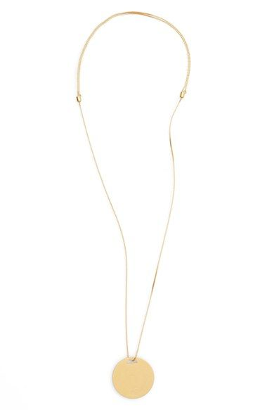 Madewell Circle Pendant Necklace at Nordstrom. A striking circular pendant dangles from a shimmering chain with an adjustable sliding closure.