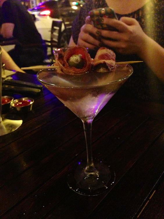 A dirty martini from ROK:BRGR, Blue cheese stuffed olives wrapped in bacon. - Imgur