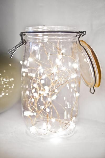 Fairy lights in mason jar or candles in them for table decor?:
