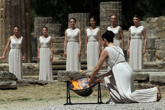 Actress Ino Menegaki, in the role of the High Priestess, lights the torch of the Olympic Flame in front of Hera Temple in Ancient Olympia, Greece, on May 10, 2012. (Credit: Orestis Panagiotou / EPA)