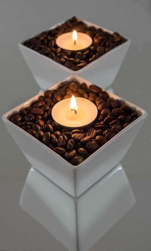 Fill shallow container with coffee beans and insert tea light. Use several for a glamorous table centerpiece or put one in front of each place setting.