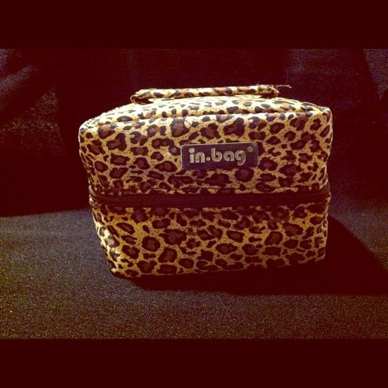 Leopard print Travel jewelry case by IN-Bag Cute leopard print travel jewelry bag that measures 5 inches long, 4 inches wide and 3 inches tall. It has 2 zippered pouches on top, 6 pouches on bottom that measure 3 1/2 inches square and  1 post earring strip on bottom. Nice and compact yet can hold more than enough jewelry for your travels! There are 2 cute surprises inside for you! In bag Bags Travel Bags