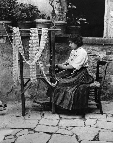 A woman on Burano Island makes the lace for which Venice is known - 1916: