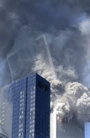 """Smoke and debris fill the air as the south tower collapses at 9:59 a.m. """"Clearly, not even the police and FBI who had flooded the area were worried about collapse,"""" said George Hackett of Newsweek. """"They wouldn't have been anywhere near to the buildings as they were. If the first building hadn't essentially fallen straight down, its crash could have killed hundreds standing, like me, a few blocks away."""""""