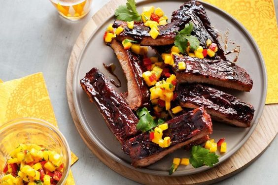 It's hard to resist these sticky, smoky pork ribs served with sweet mango salsa.