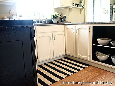 Love these black painted cupboards