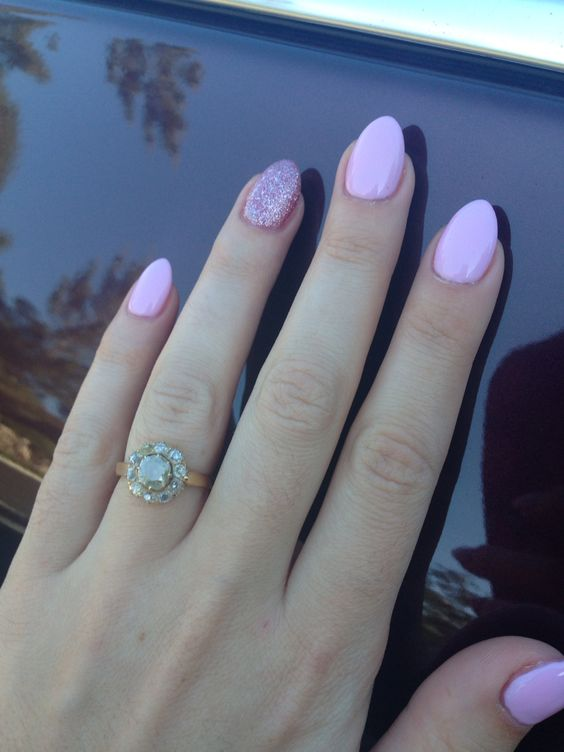 Pastel pink manicure with glitter good for short stiletto nails