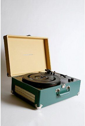 I've been thinking a about records lately.  I think they would be fun to collect...and play.  I would need a player, right?  I like how this one looks.