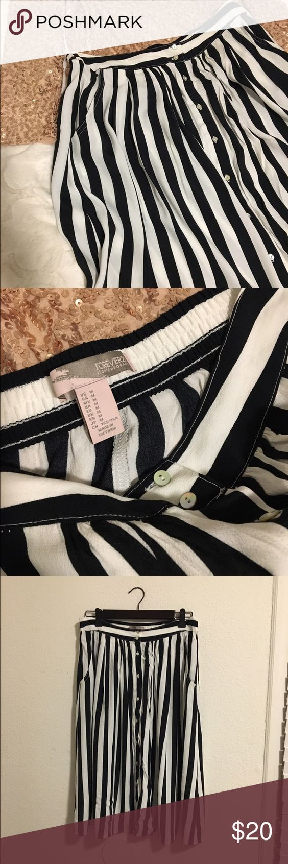 Black and white striped skirt Midi skirt with front buttons and pockets! Approximately 26 inches long. Never worn. No flaws.  please no trades. Use the offer button  Forever 21 Skirts Midi